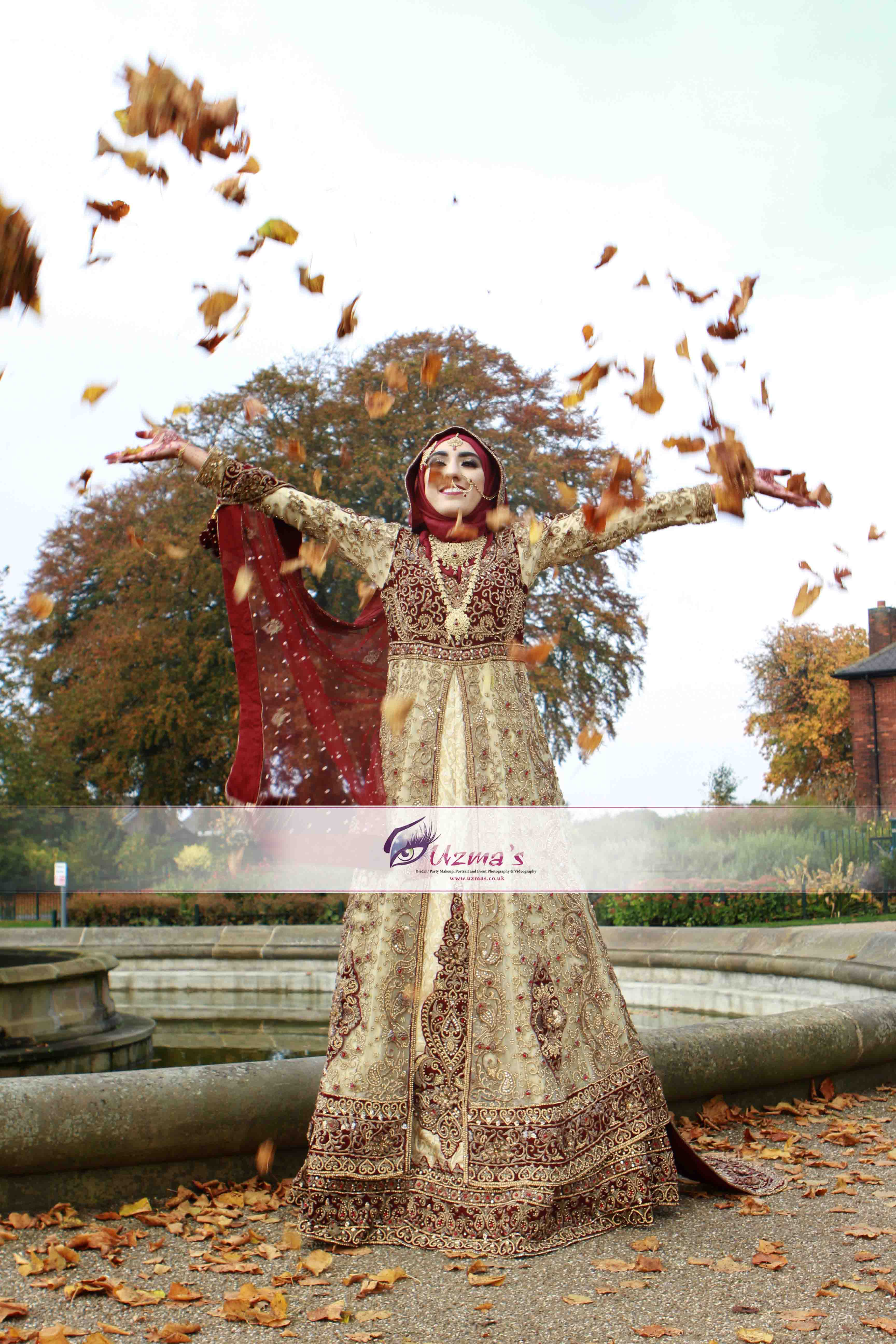 A British Muslim Bride throwing leaves in air.jpg